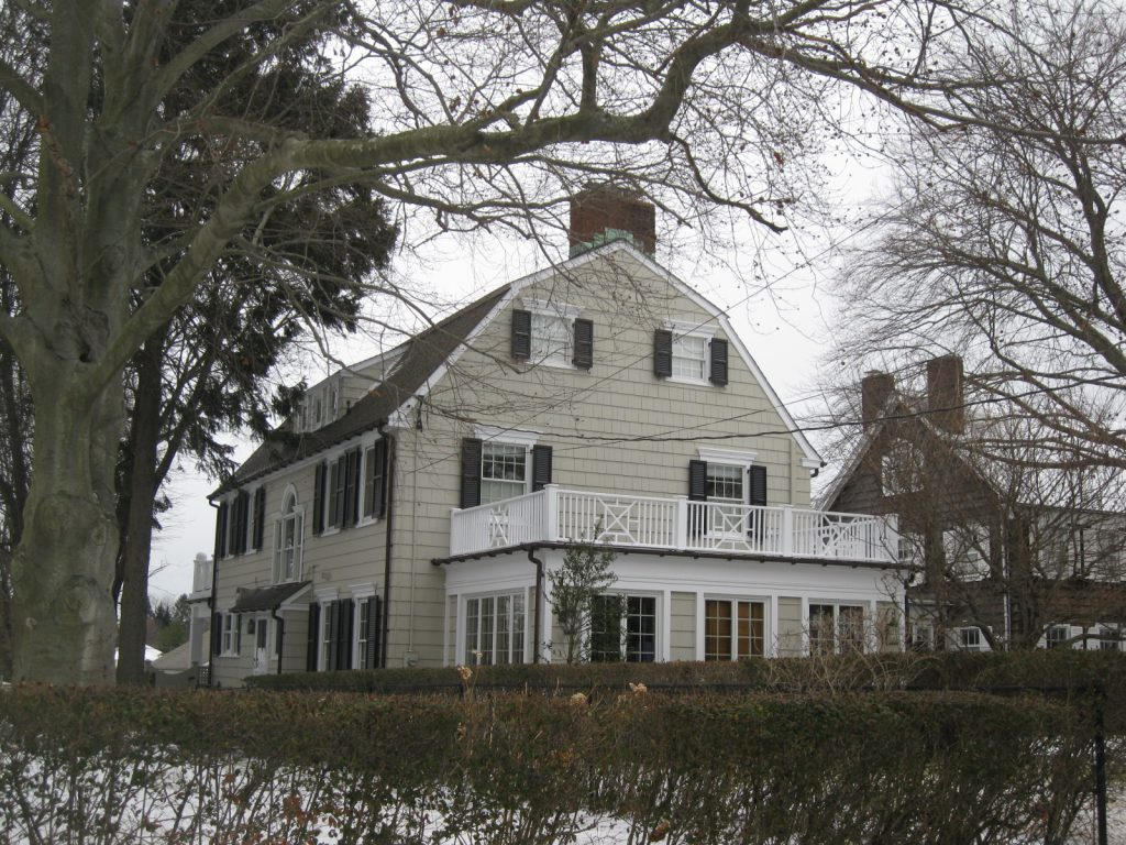 photo shows the real amityville horror house from the street.