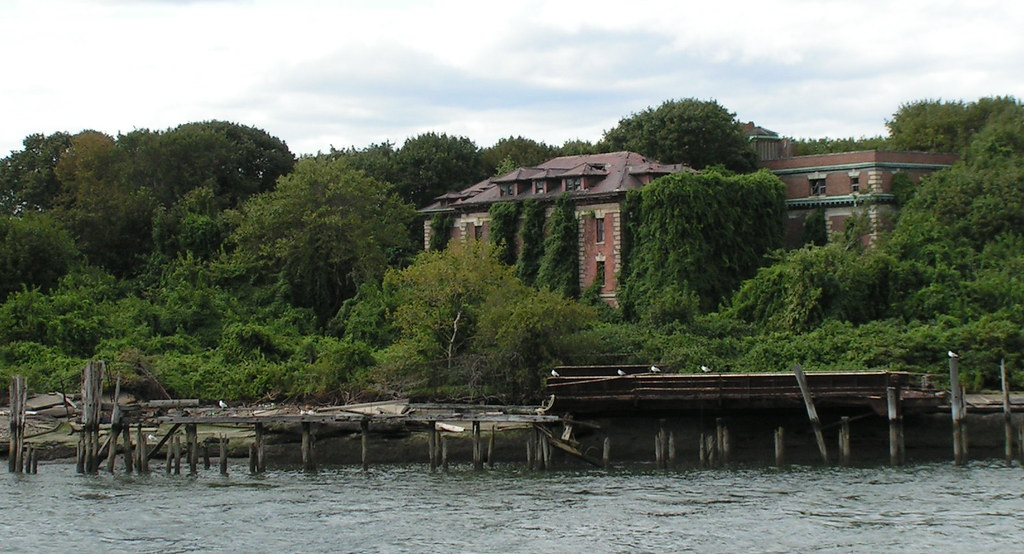 photo shows a building on north brother island covered in vines and vegetation
